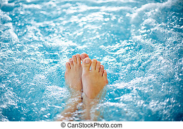 Hot tub - Close-up of female legs in hot tub