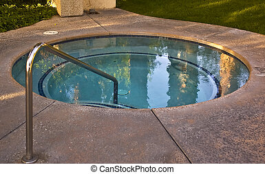Hot Tub - Relax in this hot tub by a pool.
