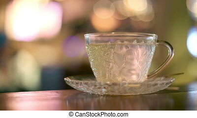 Hot water in glass tea cup