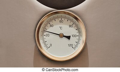 Hot water thermometer - Thermometer on a water boiler rising