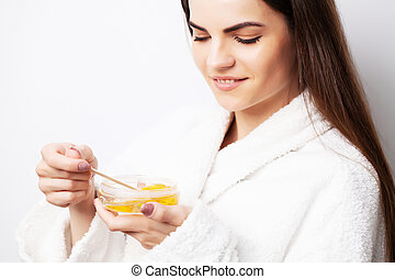 Hot wax in white bowl for hair removal.