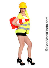 Hot woman with a traffic cone