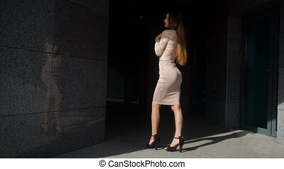 Hot young business lady looking at the camera