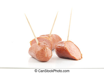 Hotdog Sampler - Sliced sizzling hotdogs with toothpicks ...