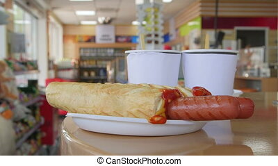 Hotdogs and drinks for lunch in petrol station convenience store