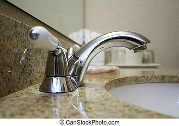Hotel 5 - Close up of Bathroom Faucet