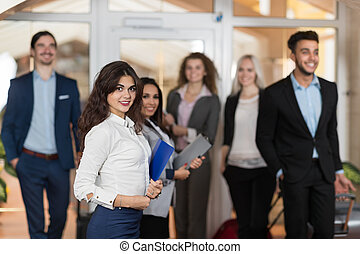 Hotel Administrator Welcome Business People In Lobby, Mix Race Businesspeople Group Guests Arrive
