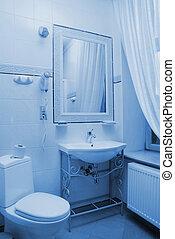 Hotel bathroom interior toned in blue