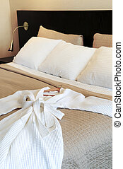 Hotel bed with bathrobe - Comfortable bed with clean ...
