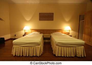 Hotel Bedroom - A interior view of hotel bed room.
