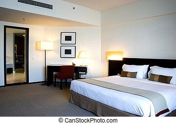 Hotel Bedroom - Image of a luxury hotel bedroom.