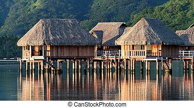 Hotel bungalows over Moorea lagoon