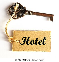 hotel key - travel concept with hotel key and tag or label