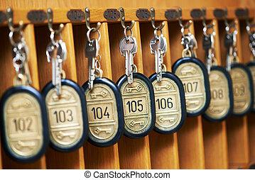 hotel keys in cabinet - hotel room keys at reseption desk...