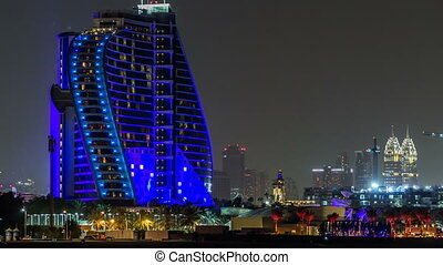 Hotel near Jumeirah beach night timelapse in Dubai, UAE.