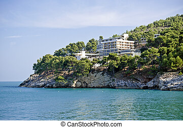Hotel on the rocky beach in south Italy