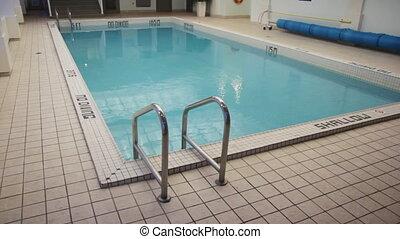 Hotel pool. - Swimming pool inside a hotel.