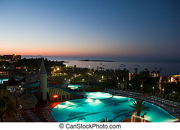hotel pool view at night - luxury hotel with pool at night