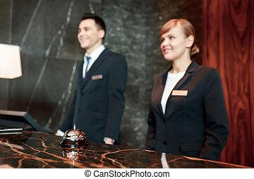 Hotel reception desk at work
