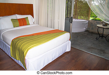 hotel room in tropics - hotel room, bed with write bedspread...