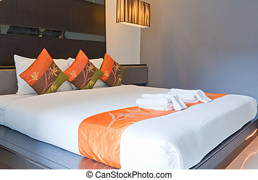 Hotel room with bed and wooden