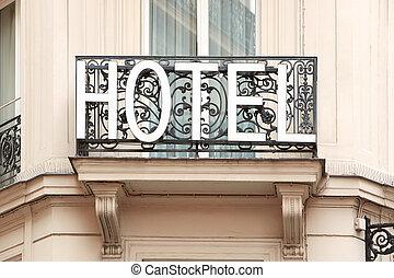 Hotel sign on balcony