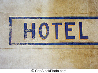 hotel sign - the word hotel painted on a wall in arles, ...
