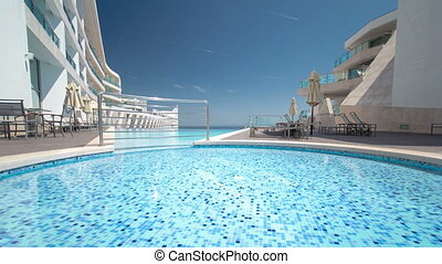 Hotel small swimming pool with sunny reflections timelapse,...