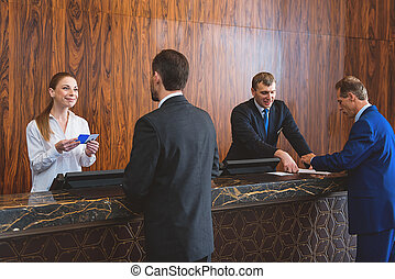 Hotel staff registering their guests