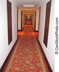Hotel - Corridor hotel. Red carpet on the floor