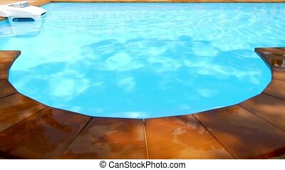 Hotel Swimming Pool with Sunny Reflections. - Blue swimming...
