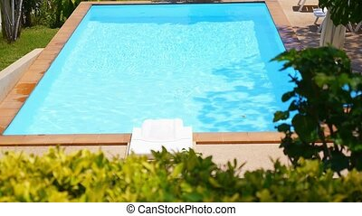 Hotel Swimming Pool with Sunny Reflections. Summer Holidays. Beautiful Sunny Landscape.