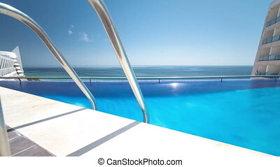 Hotel swimming pool with sunny reflections timelapse,...
