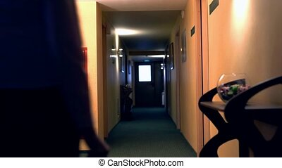 Hotel. View of business woman enters room