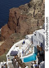 hotel with pool on caldera cliff santorini famous greek island