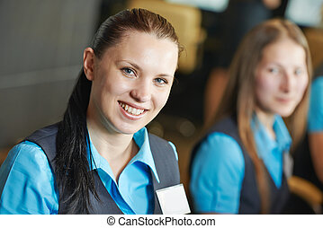 Hotel worker on reception or help desk