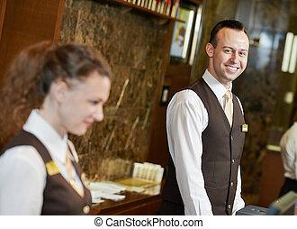 Hotel worker on reception - Happy receptionist worker...
