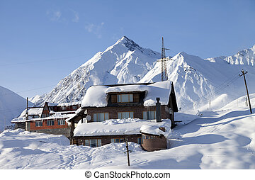 Hotels in winter snowy mountains. Caucasus Mountains,...