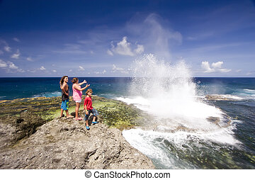Houma Blowholes 05 - Three people observing the blowholes ...