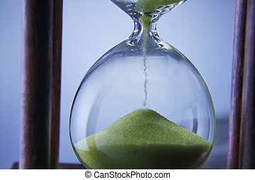 hour glass - Hourglass - Grains of sand falling down