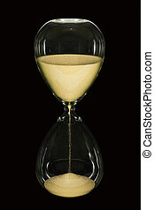 Hour Glass on black - An hourglass showing the sands of time...