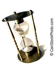 Hour Glass - Sands of time fall through a brass hour glass ...