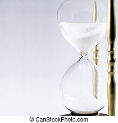 Hour Glass - Sands of time fall through a brass hour glass...