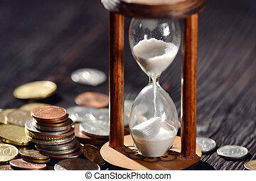 Hourglass as time passing concept for finances investments