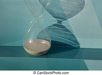 Hourglass as time passing concept for running out of time.