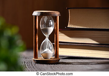 Hourglass as time passing concept for studying deadline, urgency and running out of time.
