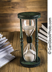 Hourglass, books, gavel on wooden