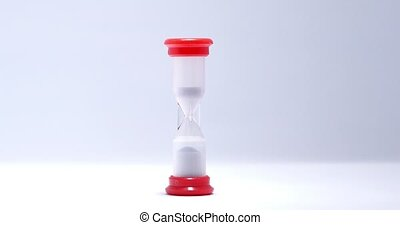 Hourglass close up on a white background.