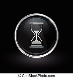 Hourglass icon inside round silver and black emblem
