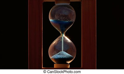 hourglass on a black background